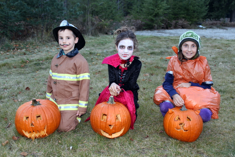 Halloween Costumes and carving pumpkins, it must be fall
