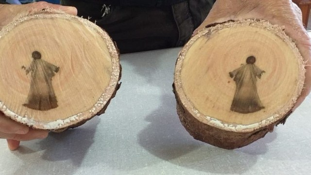 images-of-jesus-discovered-in-a-tree-cut Online Controversy: Images Many Believed to be Jesus Christ found in cut tree branch.