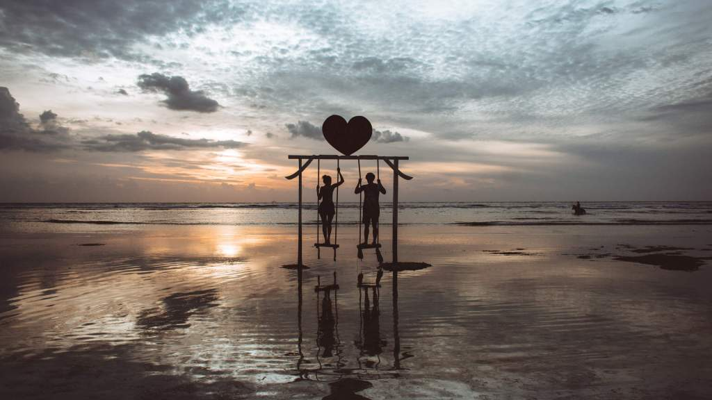 Travel couple Gili T swing Indonesia