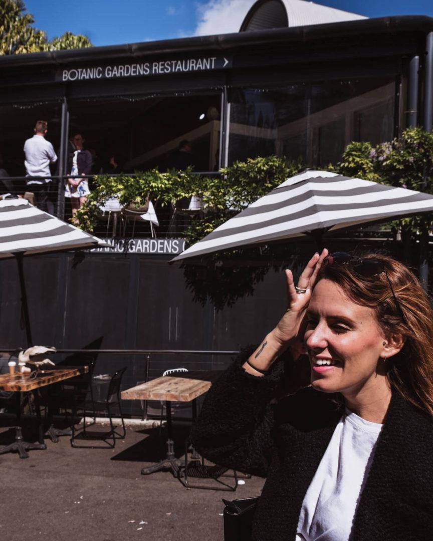 Girl smiling outside the botanic garden restaurant in sydney