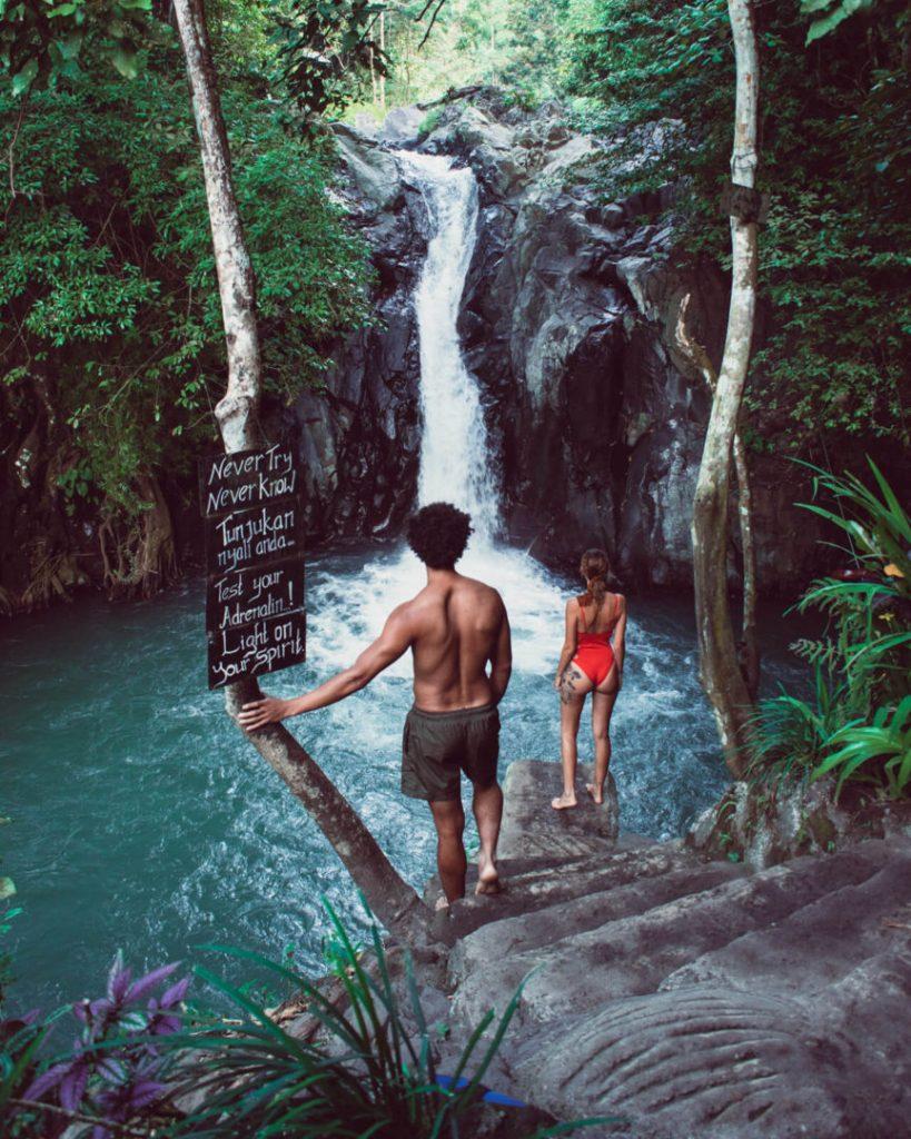 Travel couple at Kroya Kembar Pucuk waterfall near Aling Aling Waterfall in Munduk Bali