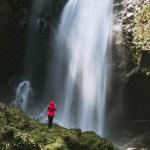 Women at Sekumpul Waterfall in red coat