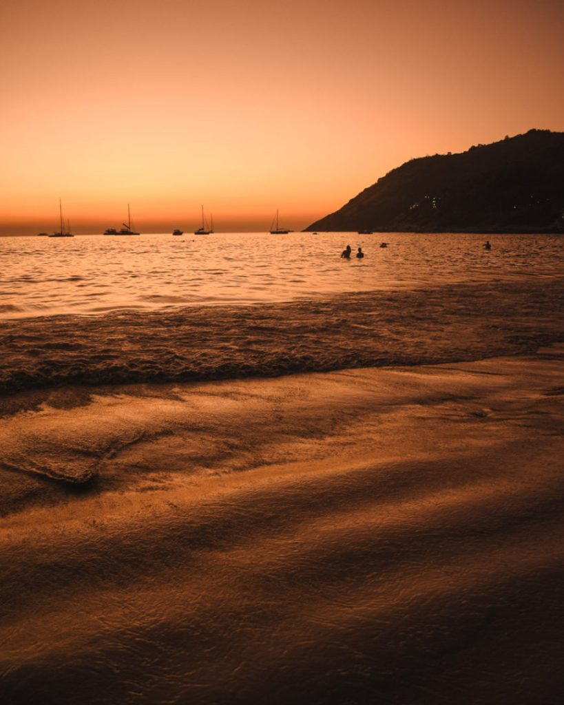 Orange sky and water as the sunset on nai harn beach