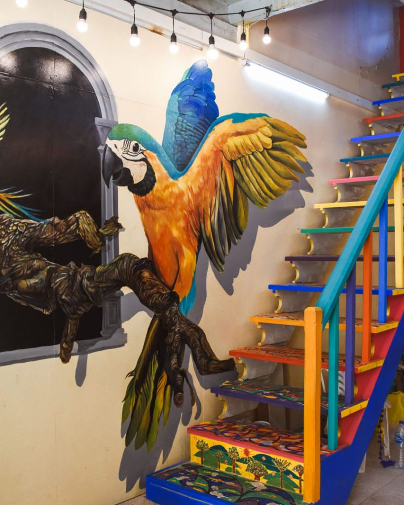 Phuket old town colourful market parrot art and steps