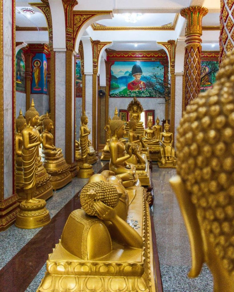 Golden buddha statues in the Wat Chalong Temple in Phuket