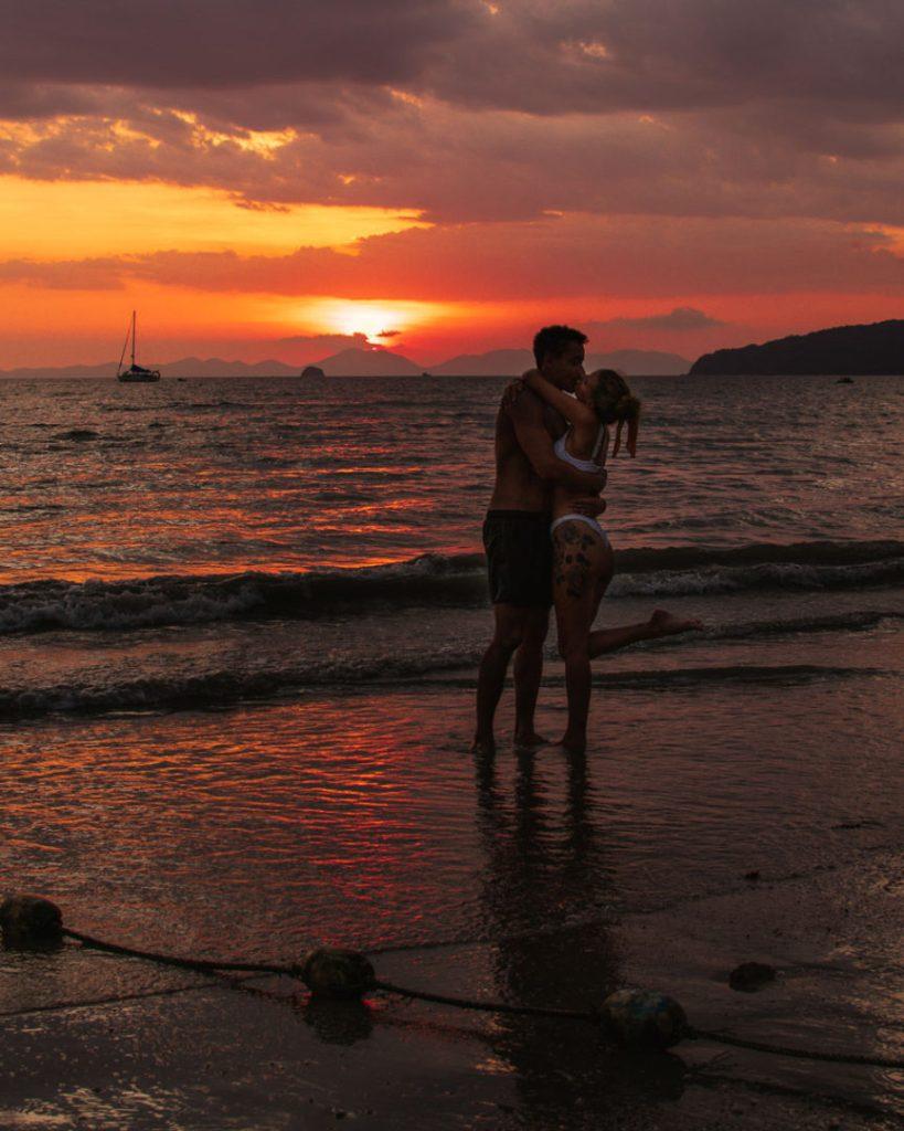 kissing on ao nang beach at sunset