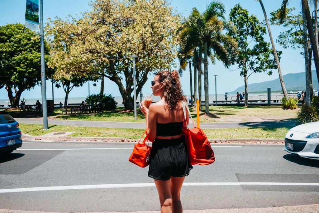 Kerrie crossing the road to the Esplanade in Cairns