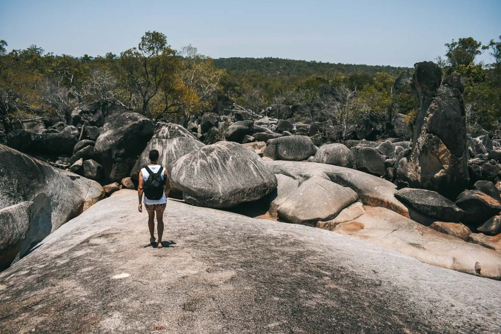 Woody walking over rocks and boulders