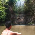 Woody looking at Millaa Millaa Falls waterfall