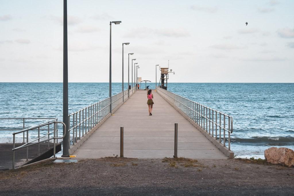 kerrie walking on jetty in mission beach