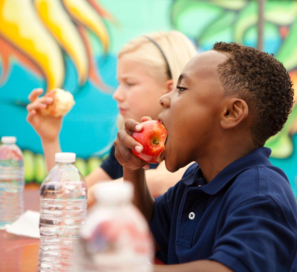 black children eating breakfast