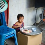 Kid eating lunch in the market