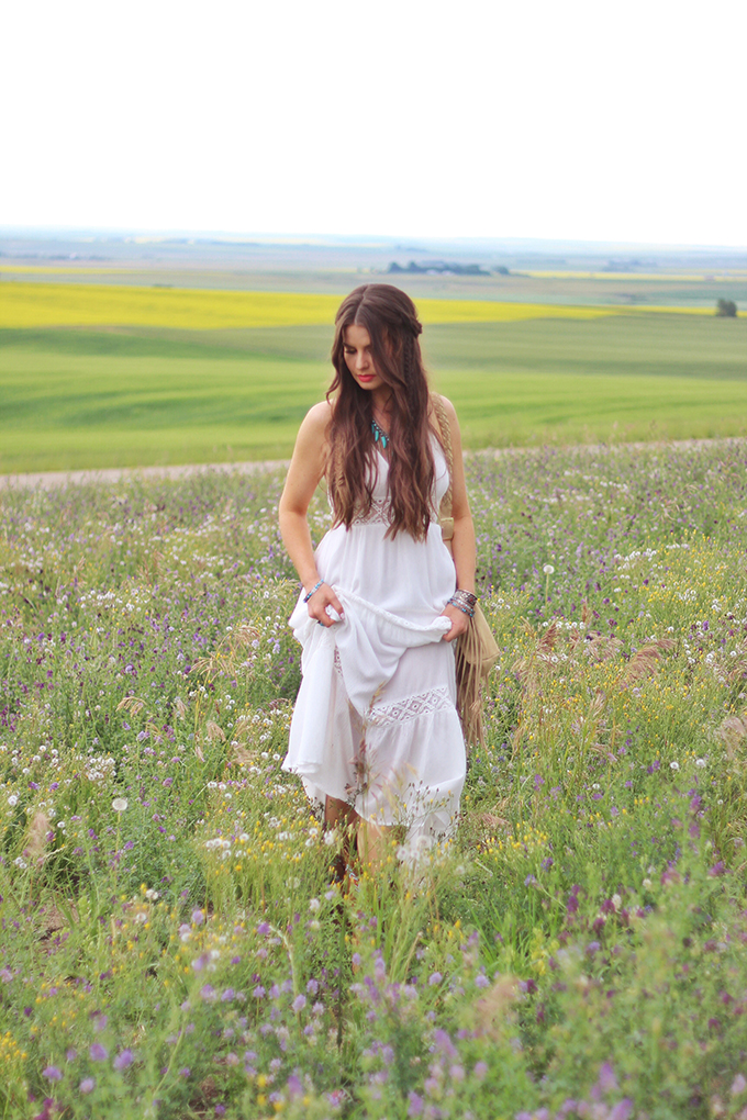 What to Wear to   The Calgary Stampede   Bohemian White Maxi Dress in a Field of Wildflowers // JustineCelina.com