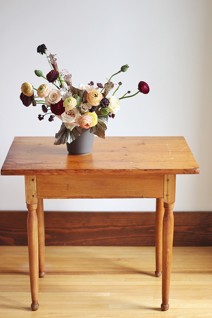 Bringing Autumn Flowers Into Your Home | A Moody, Autumn Arrangement including Ranunculus, Mother of Pearl Roses, Astrantia, Scabiosa, Saracena Lily, Poppy Pods and Angel Wings Begonia Leaves // JustineCelina.com + Rebecca Dawn Design