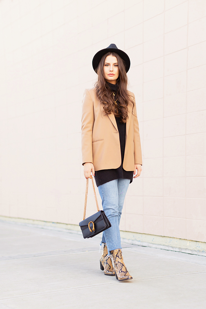 Spring 2019 Trend Guide | Modern Western: How to Style Snakeskin Ankle Boots for Transitional Winter to Spring Weather | Western Snakeskin Ankle Boots Styled With Cropped, Stem Hem Jeans, An Oversized Black Sweater, A Tan Boyfriend Blazer, a Black, Wide Brim Hat and a Gucci Dionysus Small Shoulder Bag | Bohemian Spring Transitional Style Ideas | How to Wear the Western Trend for 2019 | Calgary, Alberta, Canada Fashion & Lifestyle Blogger // JustineCelina.com