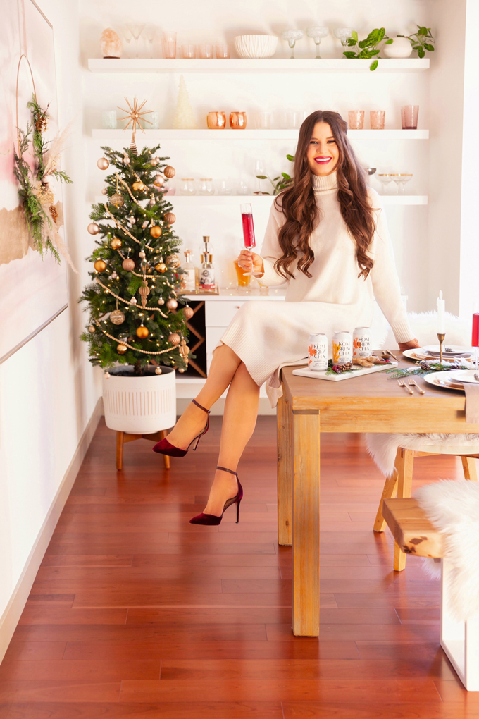 Easy Holiday Entertaining Ideas | Holiday Entertaining at Home | Stress Free Entertaining Tips | Holiday Cocktail Party | Easy Christmas Party Ideas | Simple Mid Century Modern Holiday Dinner Party | JustineCelina's Mid Century Modern Bohemian Dining Room & Bar | Candlelit Christmas Tablescape | Simple Festive Tablescape with Winter Greenery and Pampas Grass in Dim Candlelight | Kombrewcha available in Alberta | Kombrewca Review | Calgary Home Decor & Entertaining Blogger // JustineCelina.com