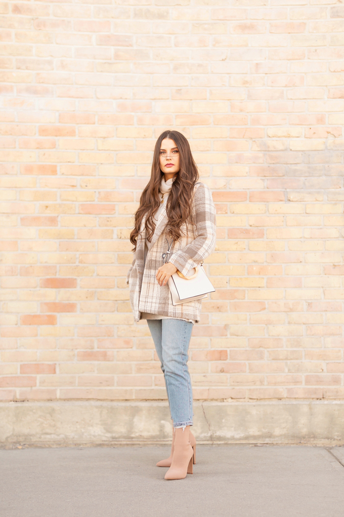 WINTER / SPRING 2020 LOOKBOOK | In Neutral | Brunette woman wearing a H&M Tan and Cream Checked Blazer, H&M Longline Cream Fine Knit Sweater, Zara Light Vintage Wash Mom Jeans, TopShop Cream Wooden Top Handle Bag and Aldo Nude Sock Boots | Casual Winter to Spring Outfit Ideas | Top Transitional Winter to Spring 2020 Trends | Canadian Winter / Spring Lookbook | How to Wear Spring 2020's Mini Dress | Transitional Winter to Spring Fashion for Canadians // JustineCelina.com