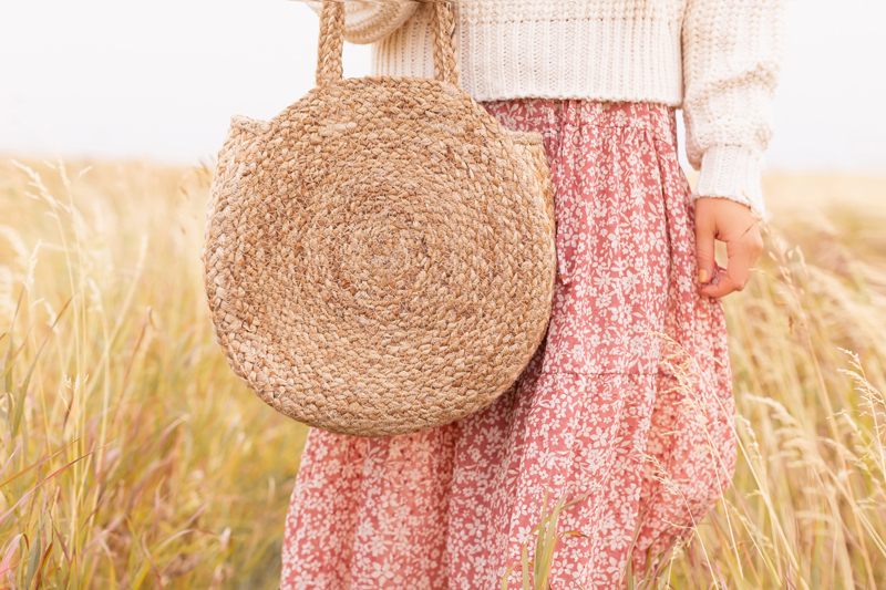 Early Autumn 2020 Lookbook | Prairie Chic | Brunette woman wearing a rose floral midi dress, a chunky cream knit and a round jute bag in a wheat field | Boho Fall 2020 Outfit Ideas | Boho Fall 2020 Outfit Ideas | Top Fall 2020 Trends | Fall on the Alberta Prairies | Thanksgiving Outfit Idea | Bohemian Fall outfit Ideas | The Best H&M Knitwear | Cottagecore Fall Outfit Ideas | How to Style Summer Dresses Into Fall Calgary Alberta Fashion & Lifestyle Blogger // JustineCelina.com