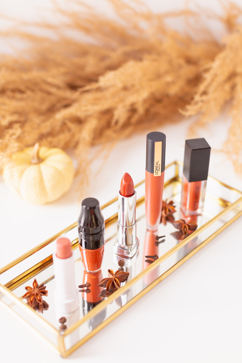 My Top 5 Pumpkin Spice Lipsticks | JustineCelina's favourite fall lipsticks | Beauty Blogger's Favourite fall lipsticks | The Best Pumpkin Spice Lipsticks for Fall | Lipstick Trends | Physicians Formula Organic Wear Tinted Lip Treatment in Gingersnap Review, Lancôme Matte Shaker High Pigment Liquid Lipstick in Abrick Adabra Review, L'Oreal Rouge Signature Liquid Lip Colour in I Amaze Review, Smashbox Always On Matte Liquid Lipstick in Out Loud Review | Calgary Beauty Blogger // JustineCelina.com