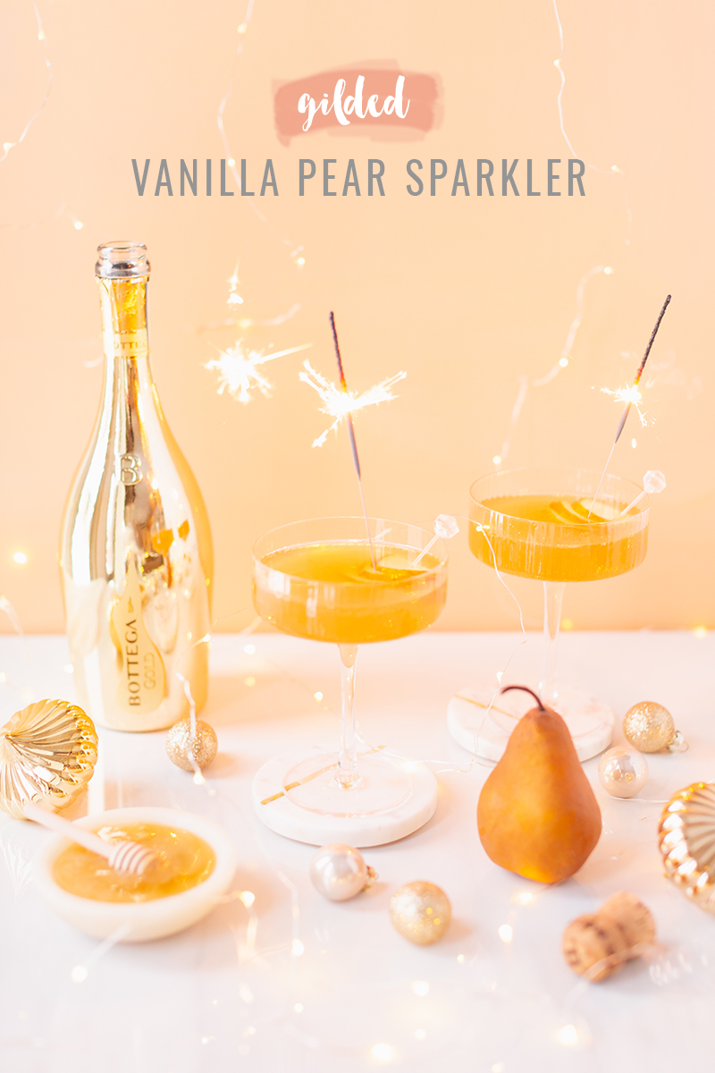 Gilded Vanilla Pear Sparkler   A glitzy, French 75 inspired New Years Eve cocktailfeaturing 24 karat gold infused gin, Brut Prosecco, Italian vanilla liqueur, lemon juice andHoneyed Vanilla Pear Syrup   Best NYE 2020 cocktails   How to Make sparkling NYE cocktails at home   Champagne cocktail recipe   Champagne Christmas drinks   New Years Eve Sparklers   Modern Refined Sugar Free French 75   NYE Cocktail Party Recipes   Calgary Creative Lifestyle & Cocktail Blogger // JustineCelina.com
