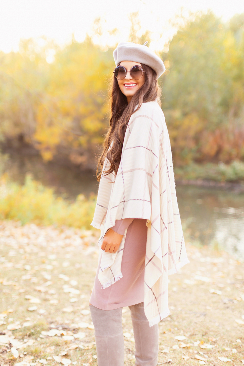Fall 2020 Lookbook | Ruana Revival | Smiling brunette woman wearing a cream ruana poncho, cotton blush sweater dress, grey beret, grey round sunglasses and grey knee high suede boots | Boho Fall 2020 Outfit Ideas | Fall in Calgary | How to Style a Poncho | Comfortable Fall / Winter Outfit Ideas | Timeless Fall Outfit Ideas | fallwinter 2020 2021 fashion trends | fall 2020 womens fashion trends | Monochromatic Fall Outfit | Calgary Alberta Fashion Blogger // JustineCelina.com