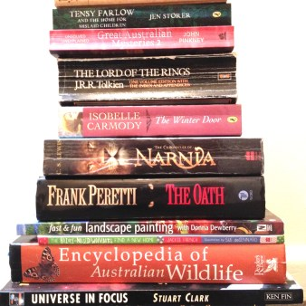 Pile of fiction and nonfictionbooks