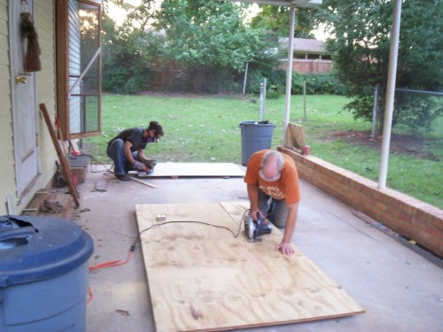 Cutting the new plywood subfloor down to size.