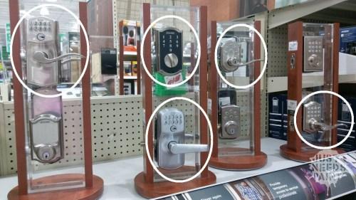 Menard's display of manual and automatic keyless deadbolts.