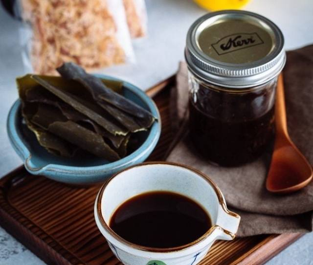 Homemade Ponzu Sauce In A Small Bowl And Glass Jar On The Wooden Tray