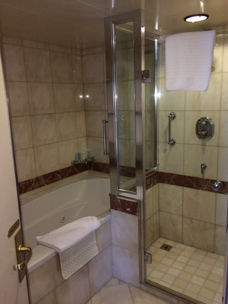 A full sized tub and shower