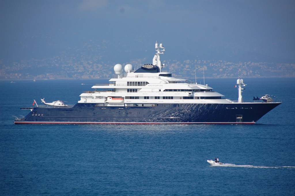 I wonder how many hours Paul Allen of Microsoft fame has to work to fill his yacht's gas tank? Count them—not one but two helicopters. Three would have been too many!