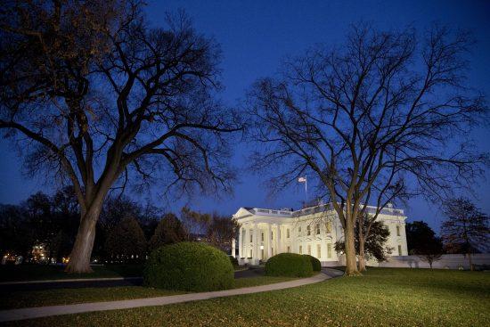 Night falls over the White House at dusk, Monday, Nov. 24, 2014, in Washington. (AP Photo/Jacquelyn Martin)