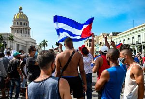 Cubans are seen outside Havana's Capitol during a demonstration against the government of Cuban President Miguel Diaz-Canel in Havana, on July 11, 2021.
