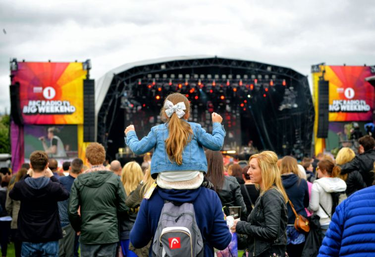 Girl dancing to one direction at radio 1's big weekend glasgow.