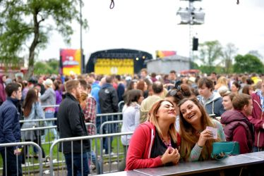 Two girls sharing a laugh at the bar at radio 1's big weekend.