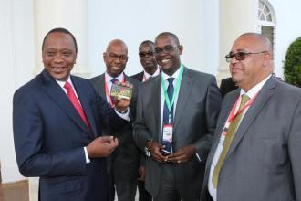 President Uhuru Kenyatta Safaricom CEO Bob Collymore Safaricom Head of Legal Nzioka Waita and MY1963 Cashless Matatu Payment Card JUUCHINI