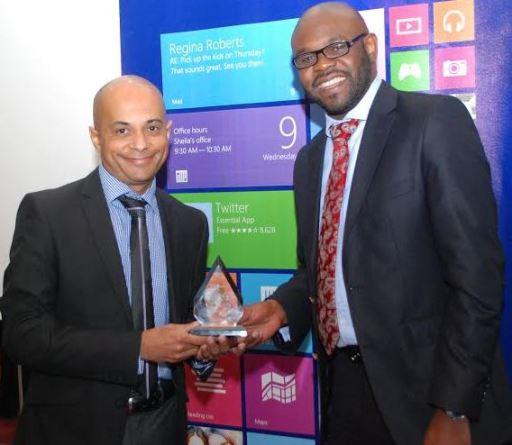 Kunle Awosika From Microsoft Kenya Presents Partner Award to Hasmukh Chudasama From Dimension Data East Africa JUUCHINI