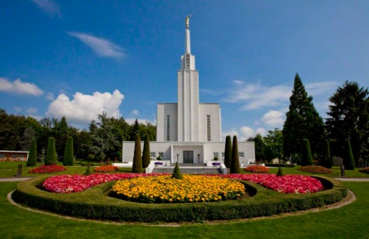 """Along the edge of a national forest, the Bern Switzerland Temple sits south of the Swiss Alps and Aare River."" via"