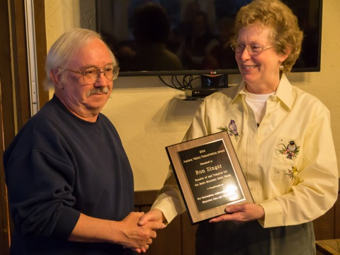 Laura Jackson, incoming JVAS President, presents the 2014 Conservation Award to Ron Singer, founder of the Jacks Mountain Hawk Watch
