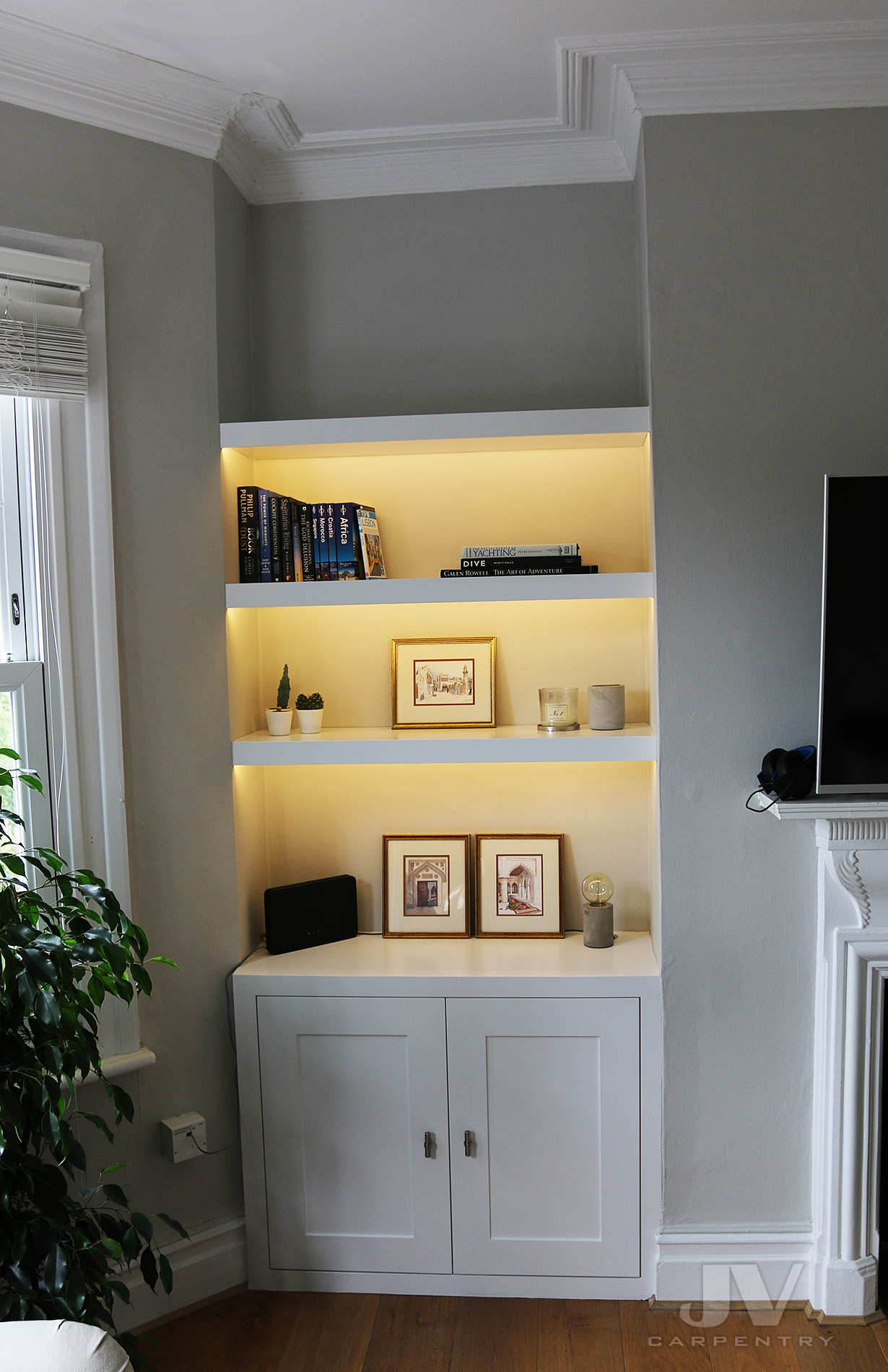alcove shelves with lights and cabinets