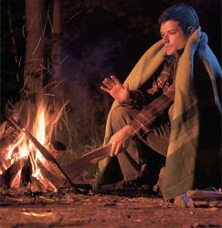 A man warming himself by a fire
