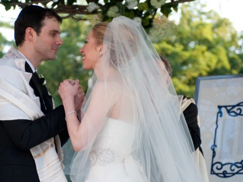 Clinton and Mezvinsky hold hands during their wedding ceremony