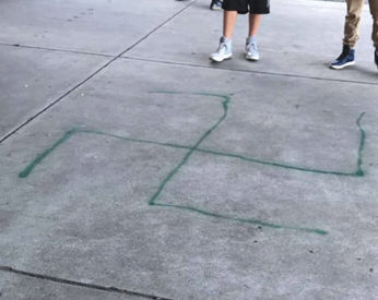 A swastika spray-painted on the ground at John M. Horner Middle School in Fremont