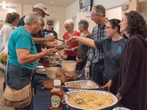 Rabbi Chai Levy and Shomrei Torah Rabbis Stephanie Kramer and George Gittleman serve food to Carol Spear (turquoise shirt), who lost her Santa Rosa home in the fire, at Congregation Shomrei Torah in Santa Rosa, Oct. 11, 2017. (Photo/Norm Levin)