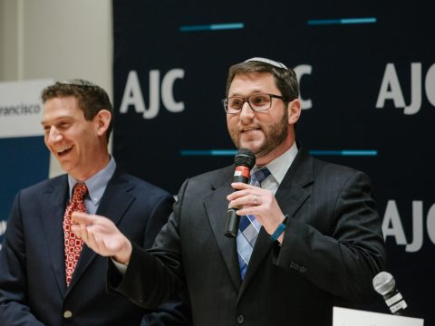 Cantor David Frommer (right) and Rabbi Corey Helfand leading the AJC Diplomats Seder, March 2018. (Photo/AJC-Mariah Tiffany)