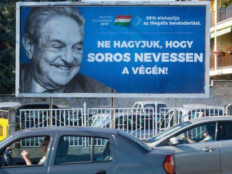 "A poster against U.S. billionaire George Soros in Szekesfehervar, Hungary, says, ""Don't let him have the last laugh,"" July 6, 2017. (Photo/JTA-Attila Kisbenedek-AFP-Getty Images)"
