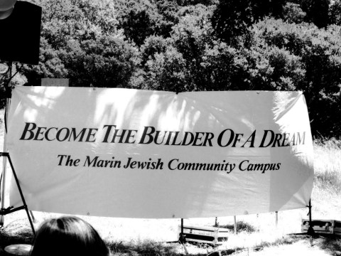 """black and white: a sign says """"Become the building of a dream: the Marin Jewish Community Campus"""