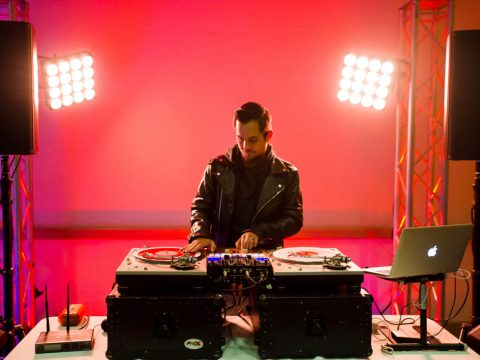 Mixwell spinning records against a bright red background