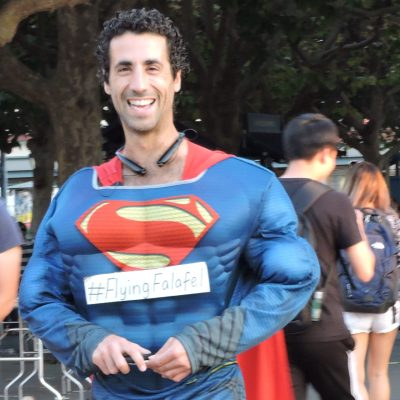 Flying Falafel owner Assaf Pashut dresses up as Superman at a Flying Falafel event.