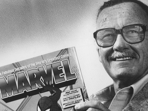 "Stan Lee poses with a book of ""Spider Man"" comics in 1991. Along with Spider Man, Lee created characters such as Iron Man, Thor and The Incredible Hulk. (Photo/Gerald Martineau-The Washington Post via Getty Images)"